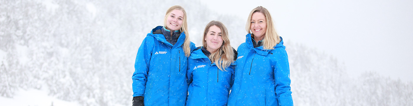 Andorra Resorts team from 2020 laughing in the snow