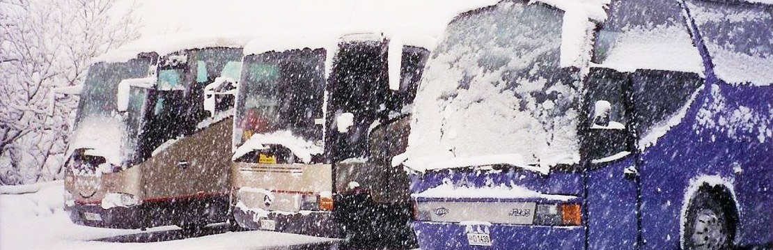 Three coaches with snow on