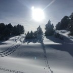 Snow and silhouettes on the Paniquera blue run