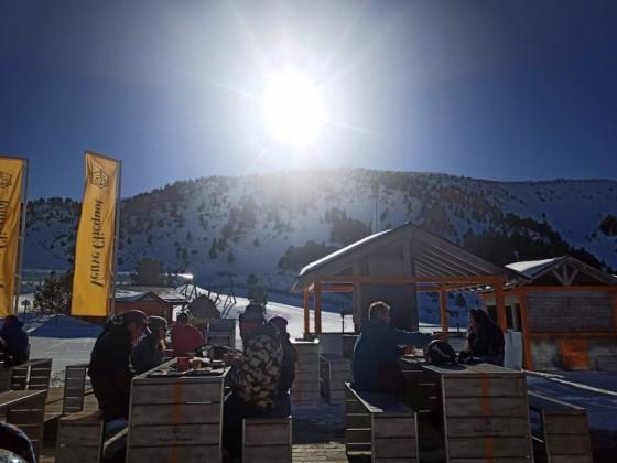 People enjoying the Veuve Clicquot terrace under the sun