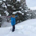 The lovely Esther posing with her Black Crows skis on powder day