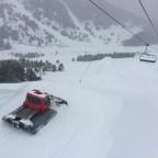 Piste basher working on the snow park in tarter
