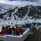 Skiiers and snowboarders enjoying their Saturday on Iqos terrace.