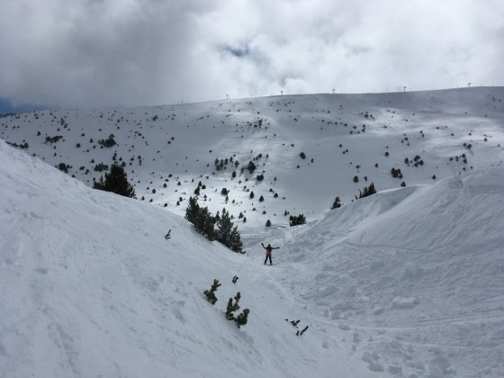 Riding off-piste through the gully under the Solana chairlift