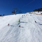 Skiers and boarders on the Duc slope