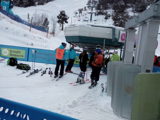 World Cup competitors catch the chairlift