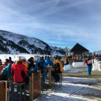 Skiiers and Snowboarders enjoying the sunshine on La Cabana terrace